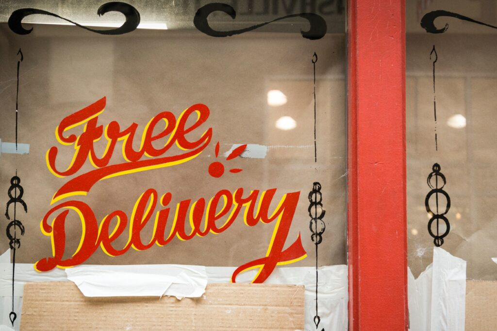 a free delivery sign in a store window
