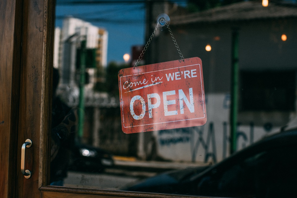 """Open"" sign at a brick-and-mortar business"